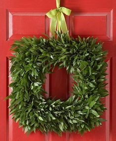 This simple green wreath is made just of bay leaves. More holiday wreaths: http://www.midwestliving.com/homes/seasonal-decorating/beautiful-holiday-wreaths/?page=4,0