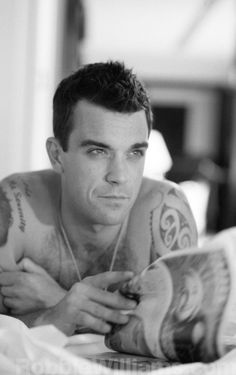 Robbie Williams (Just put in his greatest hits album the other day and remembered how much I loved him!)