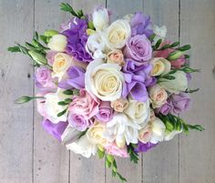 Pretty precious wedding bouquet in white, cream and lyric tones, using spring time freesias, roses and lizianthus. Lilac Wedding Themes, Purple Wedding Bouquets, Prom Flowers, Bride Bouquets, Bridal Flowers, Wedding Decorations, Flower Girl Bouquet, Flower Bouquet Wedding, Flower Bouquets