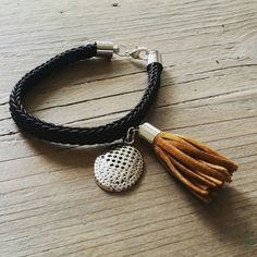 Check out this item in my Etsy shop https://www.etsy.com/uk/listing/244187148/elegant-black-bracelet-with-charm-and