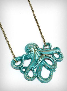 It features a large Art Nouveau inspired cast metal Octopus charm coated in a glossy sea green finish over antiqued brass, dangling from an antiqued brass cable chain. WANT!