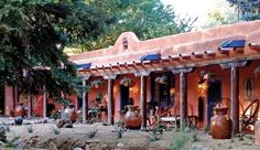SOLD! Adobe and Pines Inn, a bed and breakfast for sale Taos New Mexico, is unique, offering a range of southwest style accommodations arranged around a central compound-like area. 10 guest rooms.
