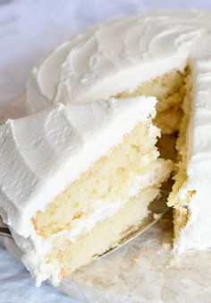 Bake a cake just like Grandma used to with this Vintage Buttermilk Vanilla Cake Recipe From Scratch. A delicate layer cake topped with homemade vanilla buttercream frosting!!