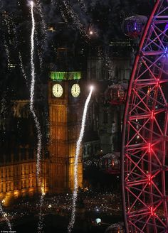 NYE 2012/2013 Fireworks light up the London skyline - including the Elizabeth Tower housing Big Ben - just after midnight