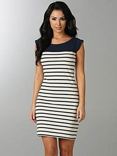 Get Naya Rivera's look from Latina Magazine Cover:Take this trend to work in French Connection's navy shift dress. We doubt this classic look will ever go out of style. ($98, dillards.com)