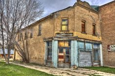 An abandoned business in Paris, Idaho. I love the S & H green stamp sign.  It makes me miss my grandmother who made me fill her stamps into the books...