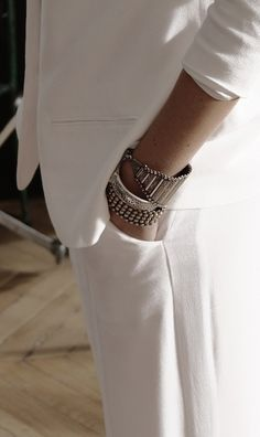 All white suit? Check. Rad arm candy? Double check.