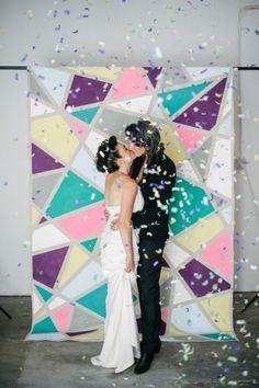 DIY a colorful backdrop for your wedding photos.