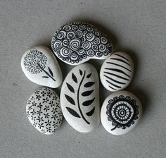 Use a perminent felt tip pen like a sharpie and draw patterns on smooth pebbles