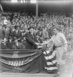 Babe Ruth shakes hands with U.S. President Warren G. Harding during a game at the Yankees Stadium. April, 1923. Ruth set career records for home runs which totalled at 714!