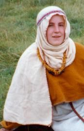 Anglo-Saxon wimple tutorial. [Picture of me wearing a simple wrap-around wimpel taken in 1996. © Rosie Monument 2001]