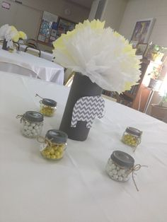 Gray and yellow baby shower center piece                                                                                                                                                     More