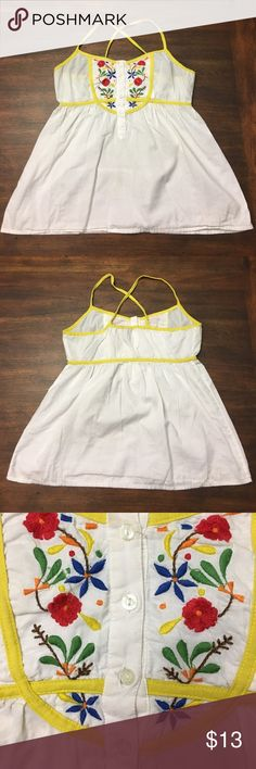 Flower embroidered tank top White tank top with flower embroidery and buttons on the chest. Yellow straps and detailing around chest. Pair this with some denim cutoffs and sandals for a chill, summer vibe. only Tops Tank Tops