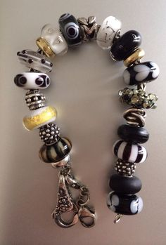 Black white and gold Trollbeads.