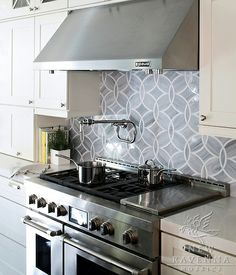 Beautiful circular patterned tile backsplash