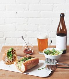 It began with a pork shoulder, as most Sundays should.  But really, slow cooked pork is to die for. We're in the happy habit of  repurposing this kind of pork for as many meals as we can think of. Taco  night? Lettuce wraps? Cold from the fridge at 10 PM? Bánh mì!?   As you may have noticed we have a new furry family member, and with our  usual routine turned on its head I think we needed a bit of normalcy in the  kitchen this past weekend. Throwing something in the slow cooker seemed  like…