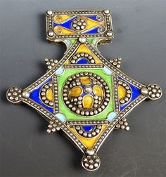 This is a beautiful vintage Berber and silver cross. The silver work shows really nice detail and lovely little silver balls covering the entire piece. The enamel work is just beautiful -- it really s