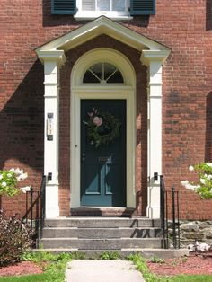 A teal door with white trim would be so pretty against red brick.