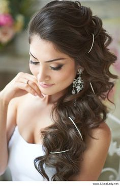 Gorgeous wedding makeup and hair. No silver thing. Ew