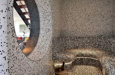 Steam room with grey color palette / mosaic tiles