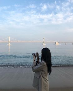 Image may contain: one or more people, ocean, sky, bridge, cloud and outdoor Aesthetic Couple, Korean Aesthetic, Aesthetic Photo, Aesthetic Girl, Aesthetic Pictures, Japanese Aesthetic, Korean Photography, Girl Photography, Ulzzang Korean Girl