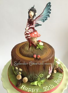 'The Fairy Brat' inspired by an Amy Brown drawing - Fairy is modelled from gumpaste and can be removed from cake and kept as a keepsake. Woodland tree stump and board airbrushed and then finished with gumpaste mushrooms, ferns and flowers and gumpaste/piped floxgloves (inspired by the wonderful work of Steel Penny Cakes)