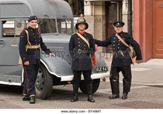 Firefighters dressed in uniforms second world war Austin Fire engine 1940s London Part of Firefighters memorial service parade. - Stock Image