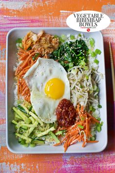 The first time I ever had the Korean dish Bibimbap was in a small family owned restaurant in NYC. I'll never forget the flavors and runny egg on top! You can make this recipe with meat too, but we love it loaded with a lot. Bibimbap Bowl, Bibimbap Recipe, Meat Diet, Spicy Soup, Korean Dishes, Us Foods, Asian, Lunches And Dinners, Food Print