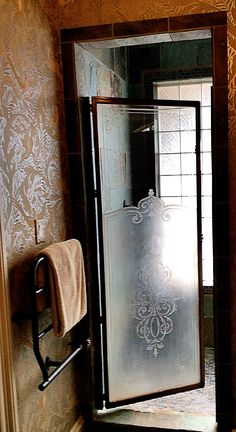 I use vintage glass and doors everywhere I can, like this vintage etched door we used on a shower. Leodowellinteriors.com