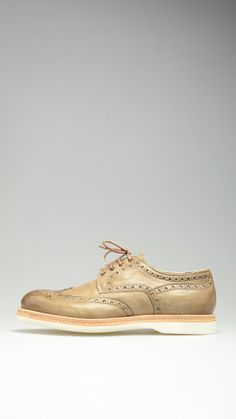 Beige delave' brogues shoes featuring non-slip rubber sole, heel height 1.2'', sturdy leather uppers with decorative perforations, derby lace ups, alternative laces, 100% leather.