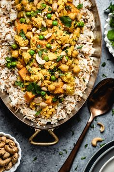 One pot, easy, and vegan cauliflower curry with coconut milk and sweet potatoes. Ready in 45 minutes, this weeknight yellow curry is packed with Indian flavors. #curry #curryrecipe#vegancurry #veganrecipe #cauliflowercurry #weeknightdinner #foolproofliving