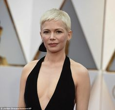Perfection:Michelle combed her platinum blonde pixie-cut to the side as she let her natur...