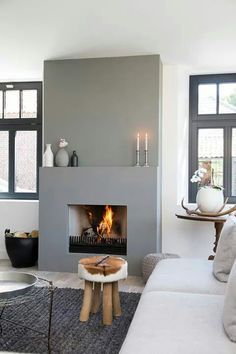 PAINT the fireplace differently. Make the Window frames a bit darker. This is so lovely!