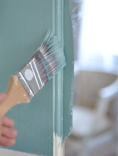 Paint color is 'Still Waters' from Glidden. Beautiful mid tone. Tips for painting interior doors from Centsational Girl