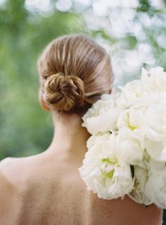 slicked back bun |  Photography by chudleighweddings.com |  Florals by brownpaperdesign.com |   Read more - http://www.stylemepretty.com/2013/07/17/palm-springs-wedding-from-chudleigh-weddings/