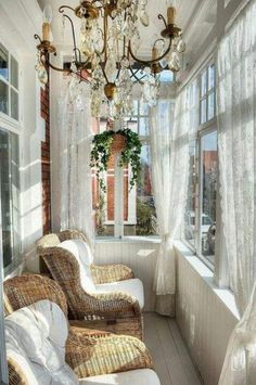 Sunroom with gorgeous chandelier overlooking garden