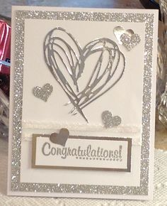 A white/silver version of my black/gold 50th anniversary card using Tim Holtz Scribbles and Splat die.