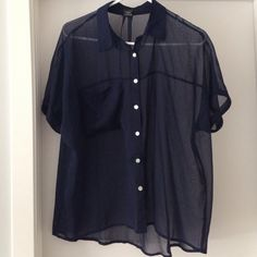 Sheer shirt Navy sheer shirt great to wear over a cute tank or pair it with a scarf! Tiny snag shown in 3rd picture Timing Tops Button Down Shirts