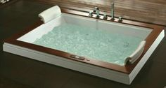 We LOVE our 2 person Aquapeutics tub with water jets, air jets, light therapy, water heater and stereo.