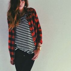 B&W stripe t-shirt with red & black checkered shirt and black jeans.