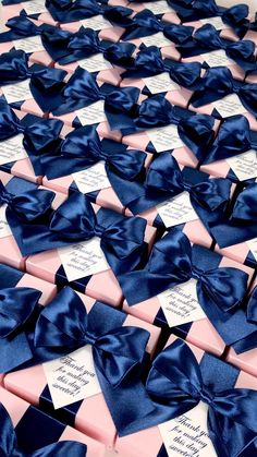 Light pink wedding favor gift boxes with Navy blue satin ribbon bow and custom tag. Elegant personalized bonbonniere for gifts and favors for your guests. #welcomebox #giftbox #personalizedgifts #weddingfavor #weddingbox #weddingfavorideas #bonbonniere #weddingparty #sweetlove #favorboxes #candybox #elegantwedding #partyfavor #weddingwelcome #bluewedding #navybluewedding #pinkwedding