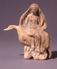 Terracotta figurine of Aphrodite seated on a goose (3rd–2nd c. BC) Culture/Period: Hellenistic. Made in: Cyprus (probably) Findspot: Salamis, grave 11, II (Salamis, Famagusta (district), Cyprus) Light orange clay; white coating, blue on waves. Mould-made, h: 16 × w: 12.7 cm. Department of Greek & Roman Antiquities, The British Museum, London, England