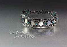 Hand woven bracelet in sterling silver with turquoise accents. --Lisa Barth