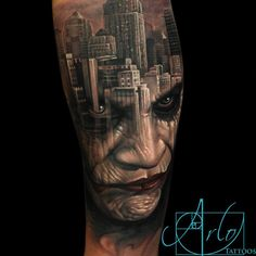 """Epic Joker piece #ArloDiCristina Based in Grand Junction, Colorado, this talented tattoo artist specializes in black and grey realism. But the young Arlo Di Cristina is truly mastering the art of composition. With the rising trend of double exposure tattoos, he is impressing the world with his """"face morph"""" tattoos. From the Joker to wise old men and gorgeous ladies, Arlo Di Cristina turns amazing portraits into real pieces of art. You can meet him at tattoo studio The Raw Canvas."""