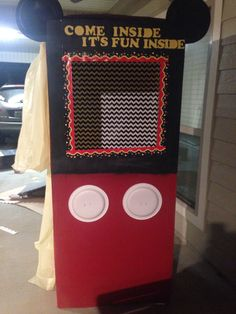 Mickey Mouse refrigerator box turned photo booth! Come inside, it's fun inside! Ears & buttons are paper plates.. Curtain is a plastic table cloth.. Chevron background is wrapping paper
