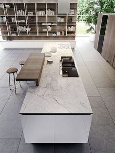 Marble kitchen island countertop along with wooden breakfast bar