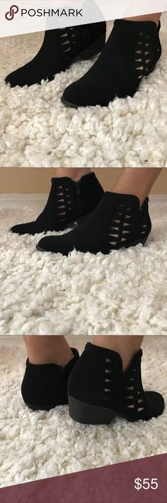 """Black Laser Cut-Out Booties  Featuring a trendy designer cut on either side, cushioned insoles, side zipper, suede and approximately 1.5"""" heel. Super comfy and stylish. Booties run true to size. Also available in brown in my closet! Unbranded Shoes Ankle Boots & Booties"""