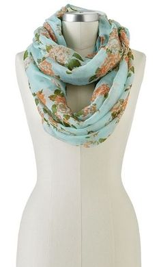 An easy way to add some floral to your look is with a scarf.