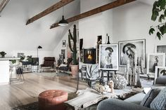 Living space with art in a Scandinavian attic apartment