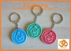 Llaveros medallon con Buda de la abundancia